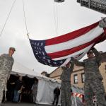 Oregon Army National Guard Soldiers help post a large American Flag