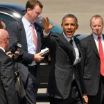 U.S. President Barack Obama waves to a crowd upon arrival at the Portland Air National Guard base, July 24