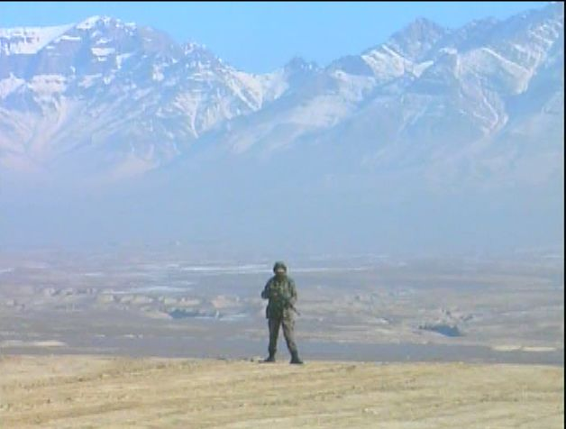 ANA soldier in front of the Hindu-Kush Mountain Range - by: Tim King