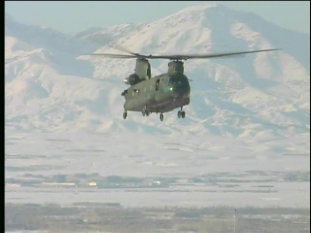 Army Ch-47 Chinook flying over the Mountains near Baghram - by: Tim King