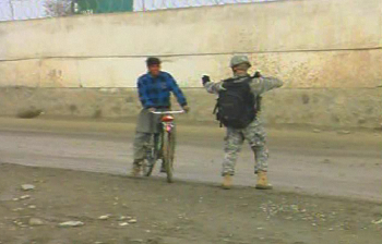 Guardsman on foot patrol stops man on bicycle - by: Tim King