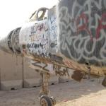 Nose of graffiti covered Iraqi Jet